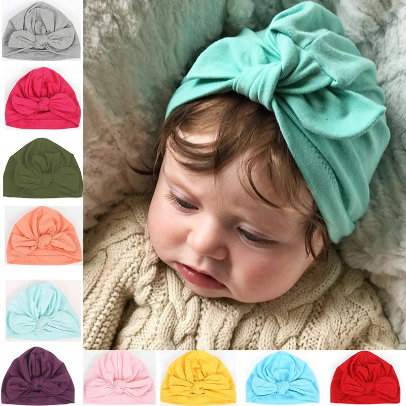 New Baby Girl Hat With Bow Cotton Newborn Bebes Knot Beanie Solid Candy  Color Infant Beanie Caps Girls Boys Hair Accessories UK 2019 From Humom 52e9cbc169ef
