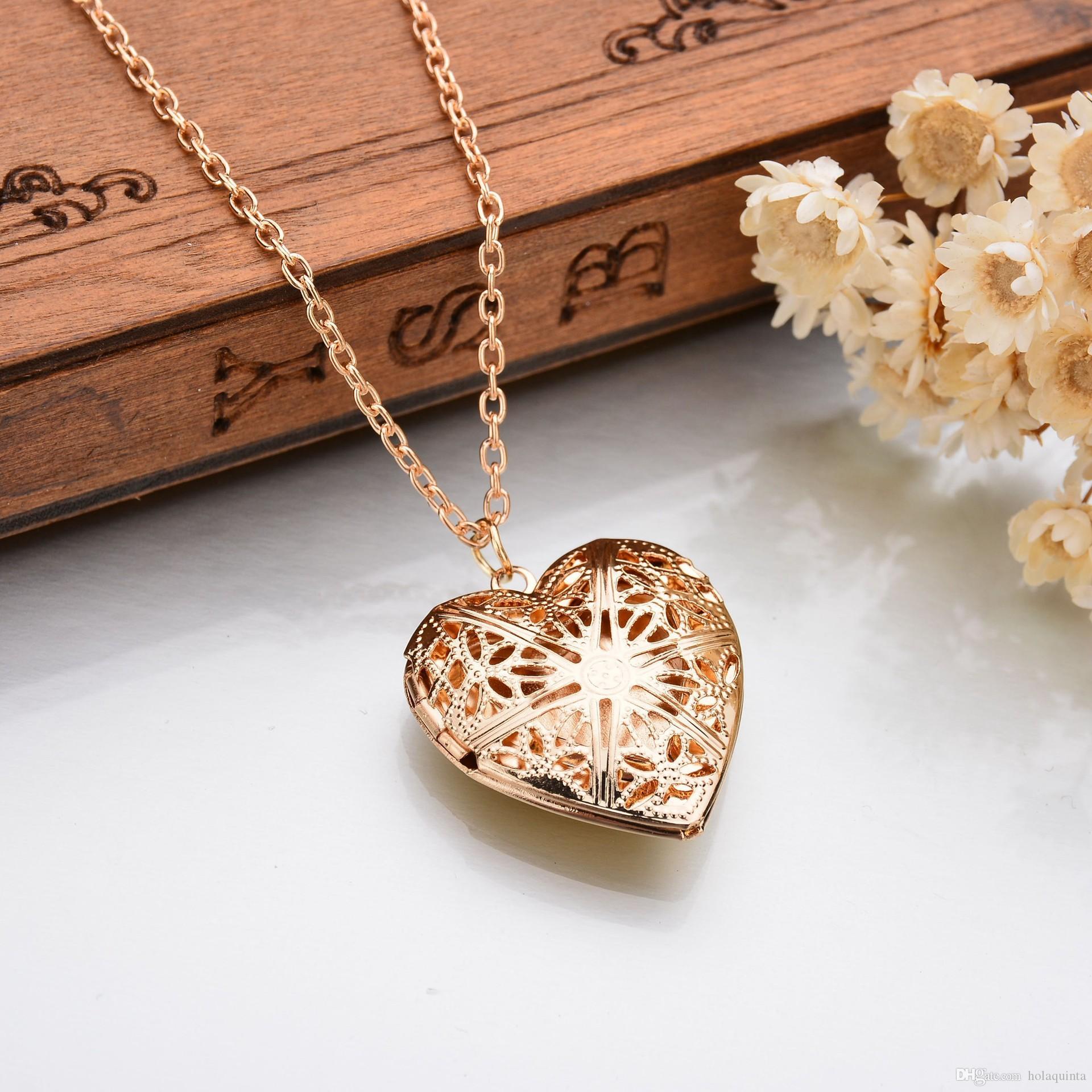 Collar hueco en forma de corazón hueco de oro Locket Mujeres Accesorios de joyería Caja de fotos linda