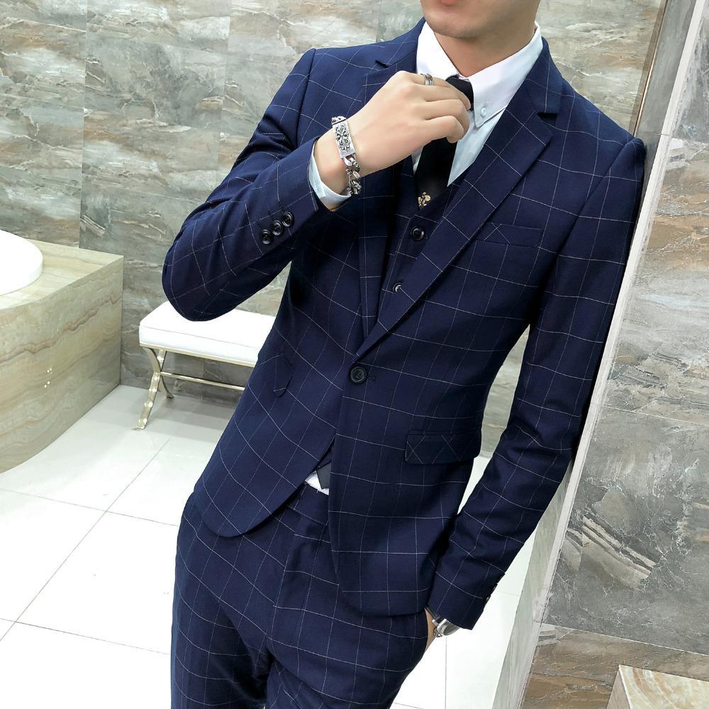 Compre Moda 2018 Nueva Chaqueta De Los Hombres De La Chaqueta Slim Fit  Estilo Británico Vestido De Tela Escocesa De Los Hombres Blazer Un Botón  Azul Marino ... 2cd6ae81246