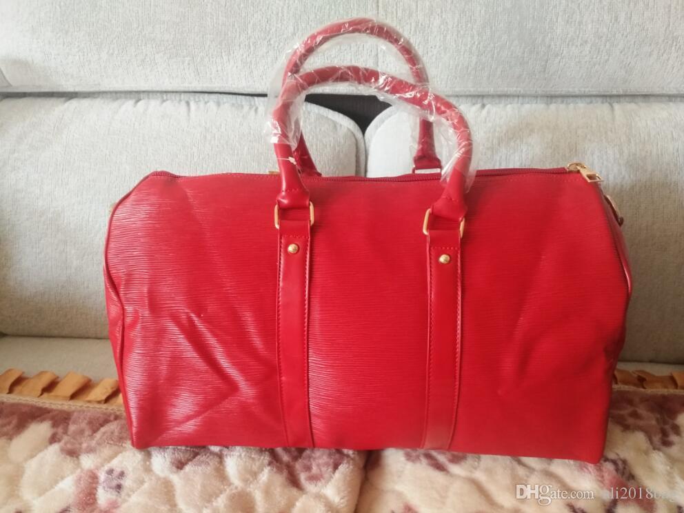 muy baratas moda atractiva realmente cómodo Hot 2018 moda bolso rojo Famosa marca diseñador hombres mujeres bolsa de  viaje bolsa de lona de alta calidad pu bolsos de hombro Totes 50 cm