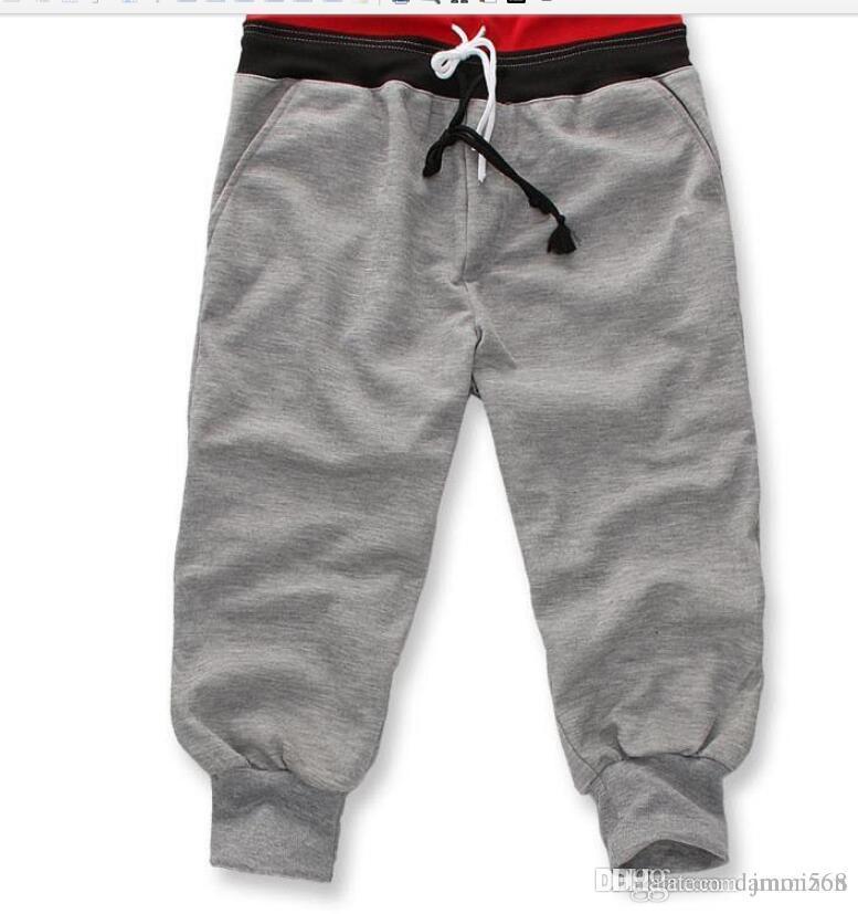 Compre Hombres 3 4 Rodilla Jogger Pantalones Cortos Deportivos Pantalones  Holgados De Gimnasio Pantalones Harem De Hip Hop Pantalones De Baloncesto  Para ... 7ee7c9e0f102