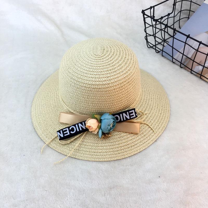 Compre Nuevo Hecho A Mano Tejido De Ganchillo Sombrero De Paja Flor De  EleBowknot Con Letra Sombreros Para El Sol Mujeres Damas Anchas Brim Summer Cap  Beach ... 9d8b715d0ad
