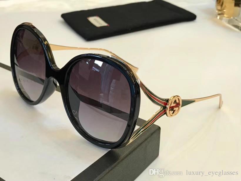 d79961bc4 Compre 2018new Designer De Moda Óculos De Sol Oco Quadro Lente Reflexiva  Verão Simples Estilo Popular Uv 400 Óculos De Proteção Ao Ar Livre Para As  Mulheres ...
