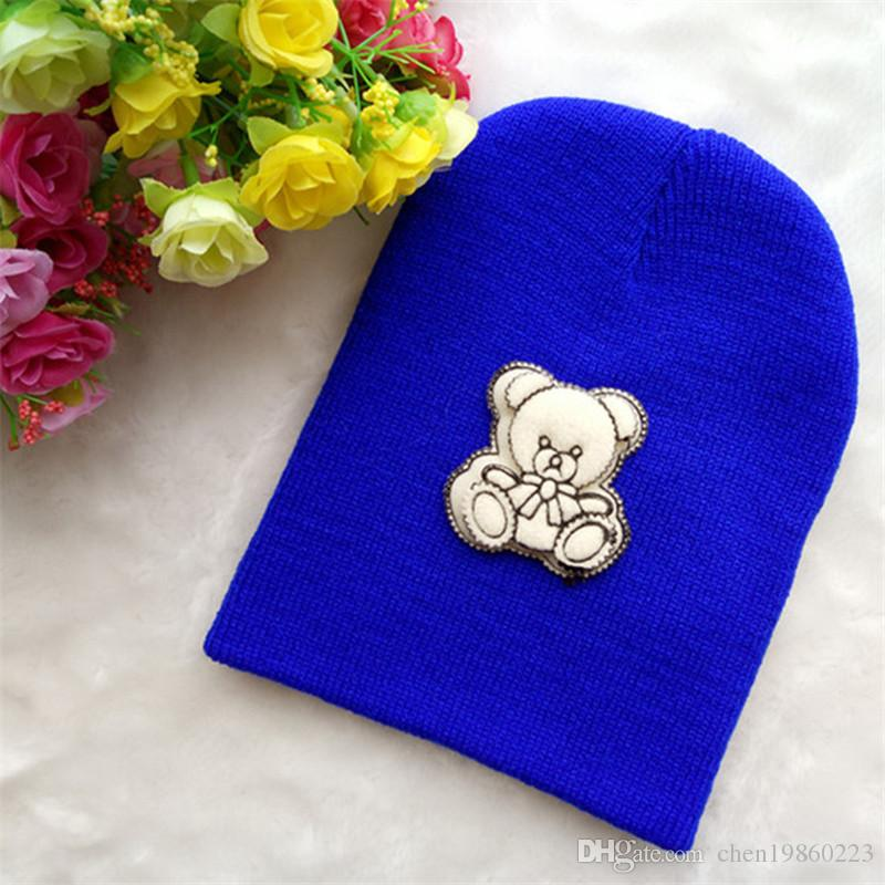 40f6a9ba9b7 Autumn And Winter Warm Male Baby Double Bear 2 Earmuffs Infant Children  Cartoon Pullover Knit Hat Wool Hat Knit Hats Cheap Hats From Chen19860223