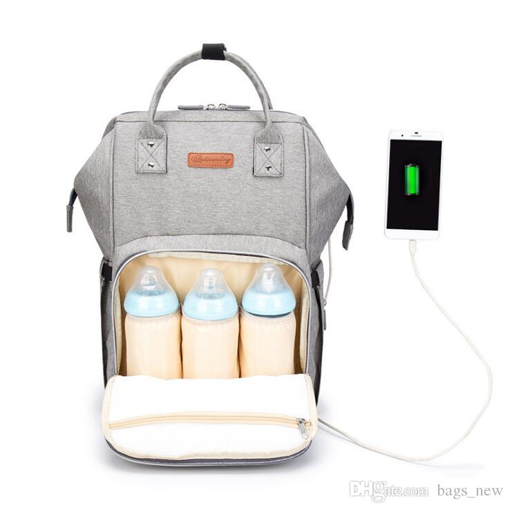 0191b4bf23 Fashion 2018 USB Interface Mummy Bag Backpack Large Capacity WaterProof  Baby Diaper Bag Maternity Carry Bolsa Luiertas Bag For Baby Care Toddler  Backpacks ...