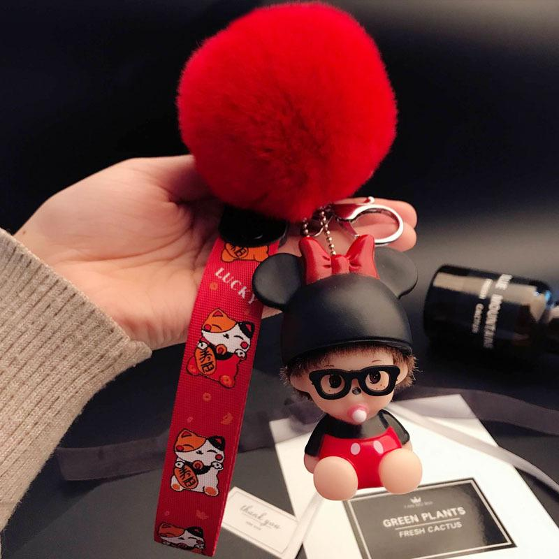 2018 Monchichi Keychain 8cm Real Pom Pom Cute Kiki Dolls Pompom Key Chain  Women Bag Car Charm Wrist Ribbon Pendant Gifts Custom Keychain Leather  Lanyard ... 230b2a43b9