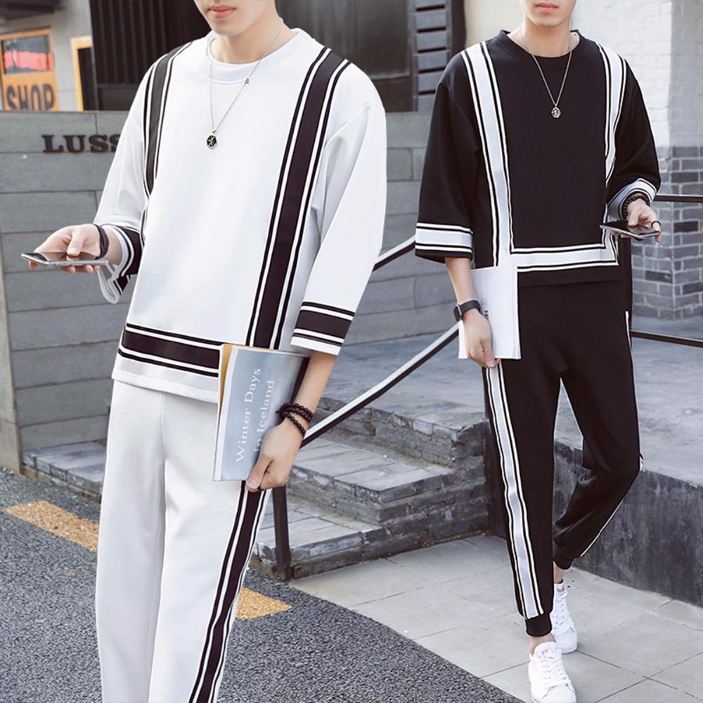 ef43f25001 Compre 2018 Otoño Invierno Casual Negro Blanco Hombres Ropa Conjunto O  Cuello Tres Cuartos De Manga Trajes De Moda Pantalones Masculinos Sueltos  Pantalones ...