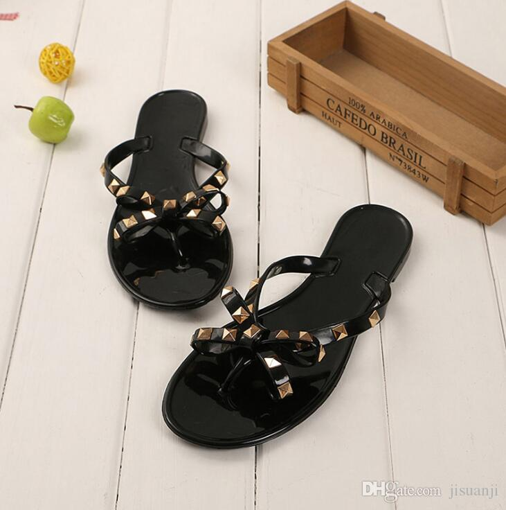 73de2a6fae8 Sexy Black Flat Woman Summer Sandals Rivets Big Bowknot Flip Flops Beach  Sandalias Femininas Flat Jelly Designer Sandals Wedges Shoes Nude Shoes  From ...