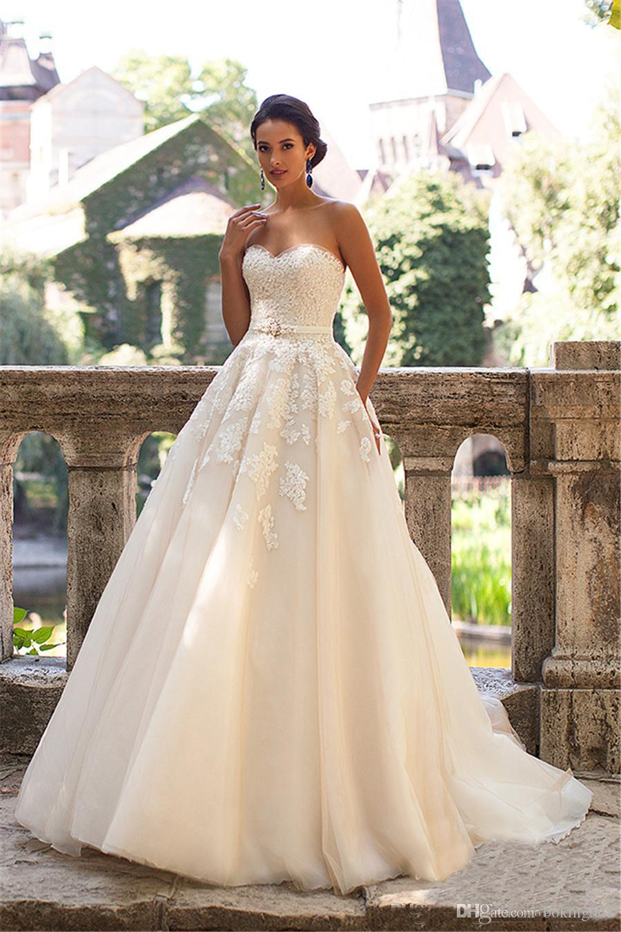 a5ee4ac3e10 Discount Strapless Champagne Wedding Gown Dress 2019 Crystals Castle Lace  Applique Wedding Dresses A Line Lace Up Wedding Dress Vestidos De Novia  Bride ...