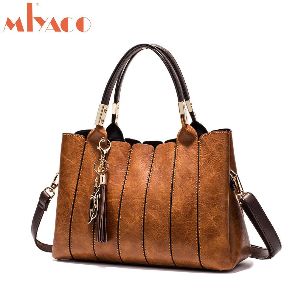 3f47289184 MIYACO Luxury Women Handbag Vintage Brown Female Totes Shoulder Bag  Messenger Bag Leather Top HandBags With Tassel Fox Y18102004 Handbag  Wholesale Womens ...