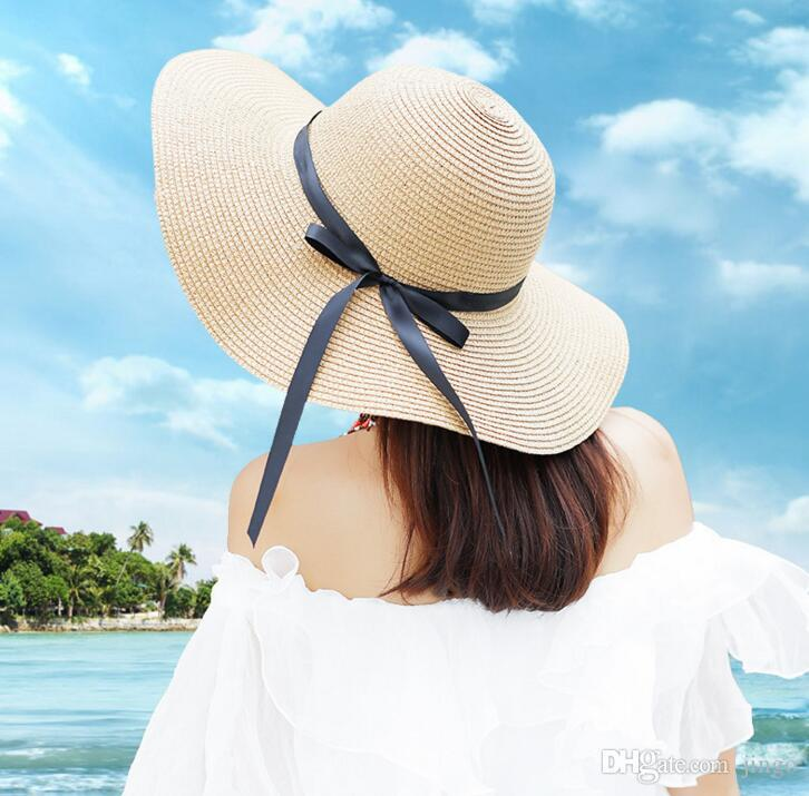 Women S Big Brim Sun Hat Floppy Fedora Foldable Bowknot Straw Hat Summer  Beach Hat Party Accessory Solid Color Party Hats Solid Party Hats From ... ac612e321a44