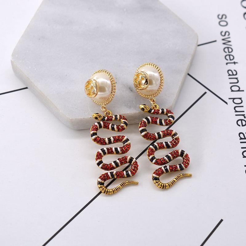 Luxus designer schlange diamant ohrstecker für frauen strass schlange tier ohrringe anhänger frauen accesscires perle blume ohrringe D50