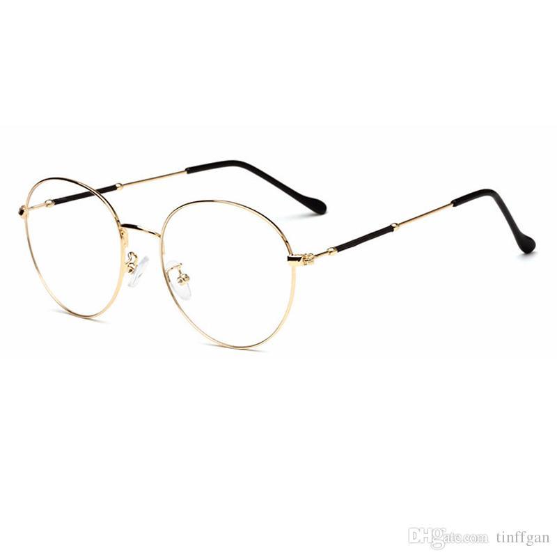 Compre 2018 Nova Moda Rodada Armações De Óculos De Armação De Metal De Boa  Qualidade Homens Mulheres Espelho Simples Óptica Óculos De Armação Para  Miopia ... 00fc78a7ff