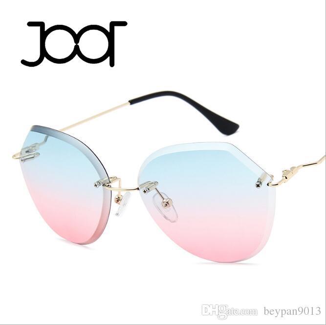 Compre 2018 Moda Sem Aro Luxo Óculos De Sol Cat Eye2 Cores Sombra Óculos  Óculos De Sol Das Mulheres Dos Homens Óculos De Sol Para A Marca Designer  De Melhor ... 541b94609c