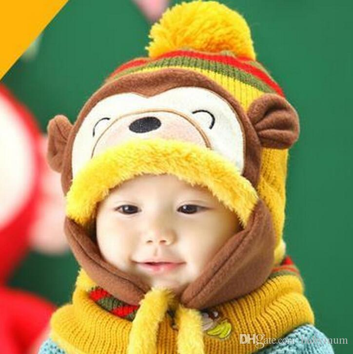e1b5d1b2632 2019 Baby Knitting Crochet Beanie Warm Fleece Earflaps Monkey Hats Boy Girl  Caps Infant Winter Hats For Kid Stripe Cartoon Animal Hats From Babymum