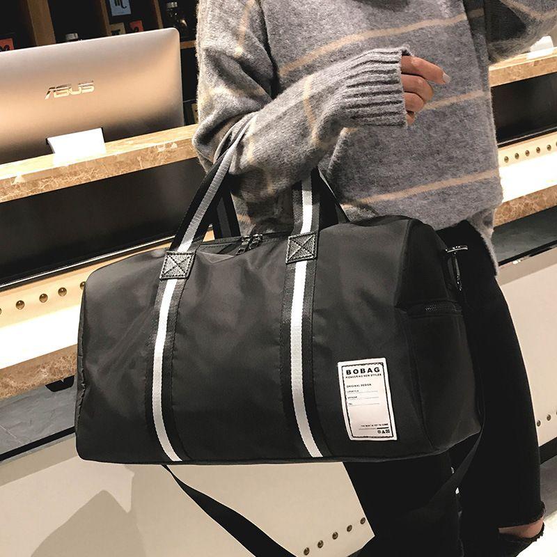 2018 New Travel Bag Men Handbags Large Capacity Business Handbag Men Women  Travel Bags Nylon Traveling Duffel Bag Bags Online Leather Handbags From  Liya8 e02a65a6fa221