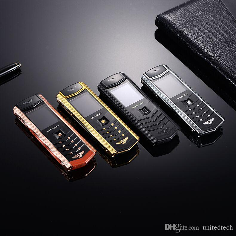 Marca original MPARTY LT2 Cuerpo de metal dorado de lujo Carcasa de cuero Teléfono móvil Teléfonos móviles Dual Sim Bluetooth FM Cámara Mp3 teléfono móvil