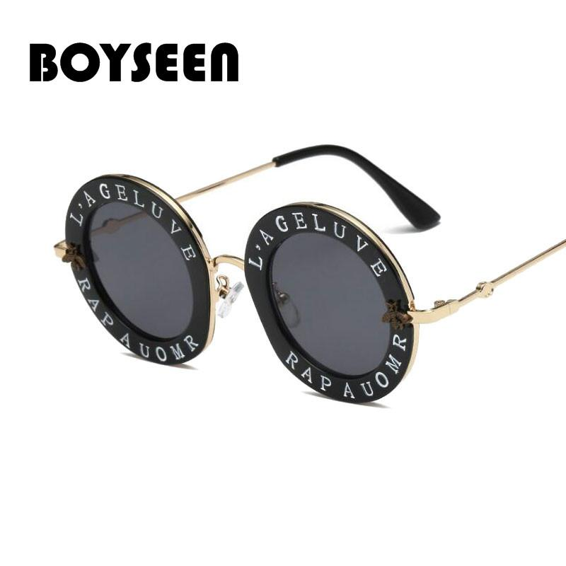 2e34eba2cc Wholesale 2018 Small Round Sunglasses Women Retro Fashion Pink Mirror Lens  English Letters Frame Ladies Sun Glasses Shades 1828 Online with   19.22 Piece on ...
