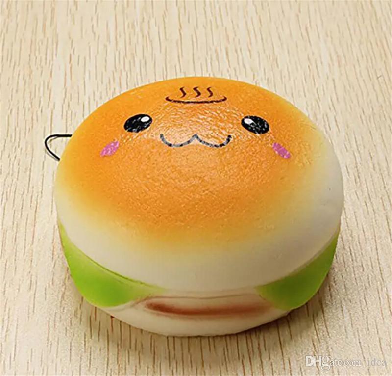 2018 10 cm Lindo Jumbo Suave Squishy Sonrisa Encantos de la hamburguesa Crecimiento lento Kawii Kids Toy Emoji Correas de teléfono para la decoración del teléfono celular