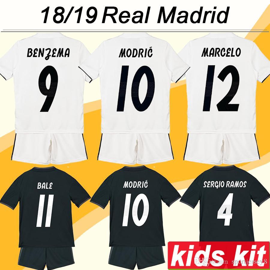 e0738d8eef Compre 2018 19 Real Madrid Kit De Fútbol Para Niños MODRIC SERGIIO RAMOS  KROOS Jerseys De Fútbol Para El Hogar Infantil BENZEMA MARCELO ISCO  Football Boy ...
