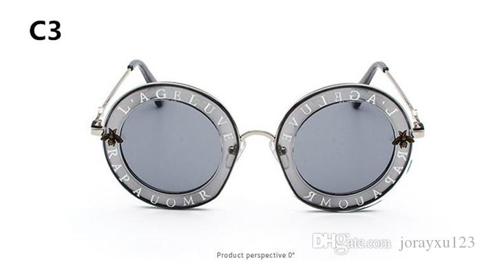 100 adet kadınlar marka güneş gözlüğü yuvarlak şekil kristal çerçeve moda yaz stil lens ile yeni kılıf J035