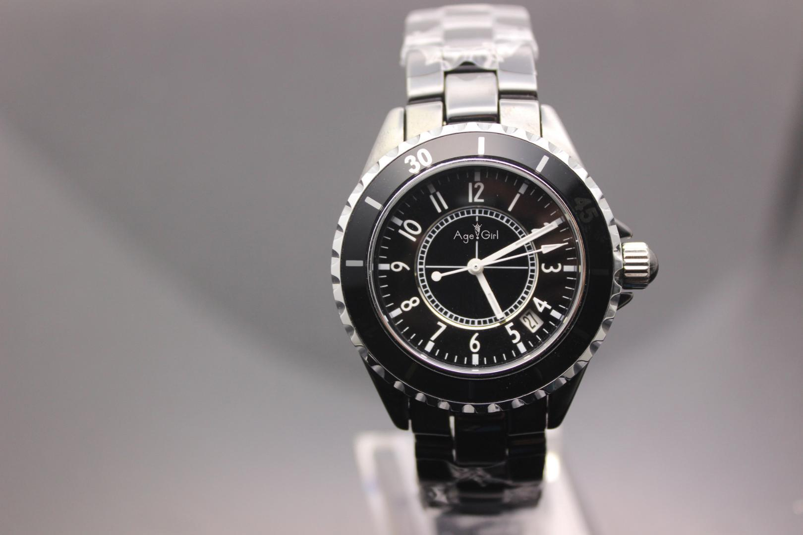 6026f4cf5b32 Compre Nueva Marca Para Hombre O Para Mujer Reloj De Cerámica Negro   Blanco  Vestido Cuarzo Rhinestone Relojes De Cerámica De Lujo A  57.55 Del  Mandarin18 ...