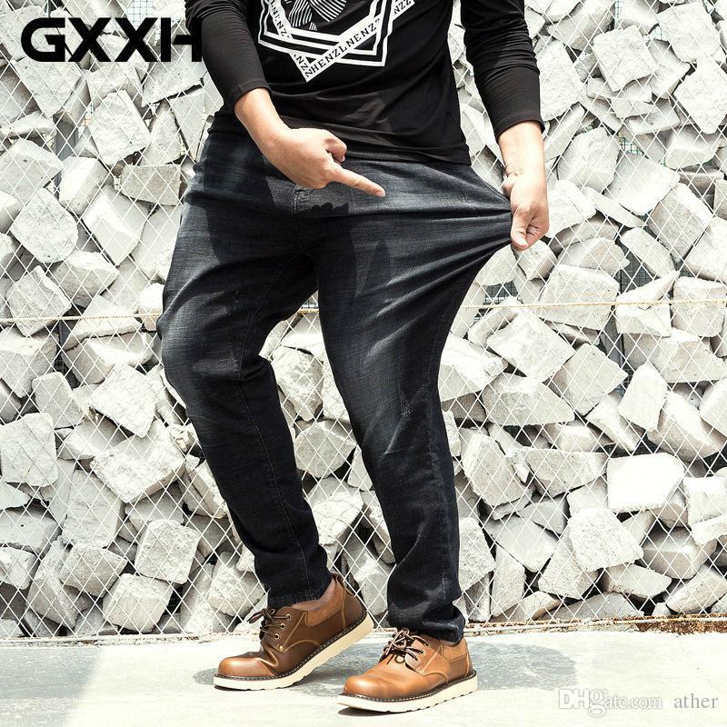 8706a9759 Compre Tamanho Grande 30 48 Dos Homens Calça Jeans Stretch Calças Lavadas  Hip Hop Designer Baggy Jeans Mens Solto Fit Casual Plus Size Calças  Elásticas De ...
