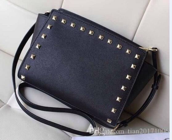 2016 star models with cross pattern PU leather handbags and small rivet smiley bat bag shoulder bag Messenger bag