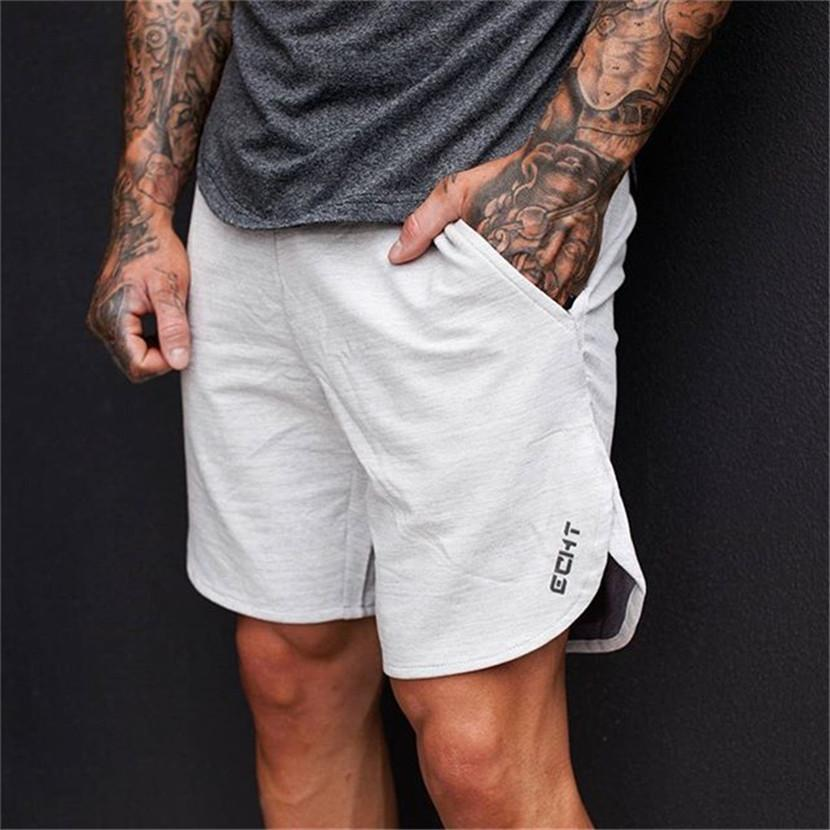 456ac301ad05dc 2017 Summer Mens Brand Jogger Sporting Shorts Slimming Men Black  Bodybuilding Short Pants Male Fitness Gyms Shorts Workout UK 2019 From  Yanmai