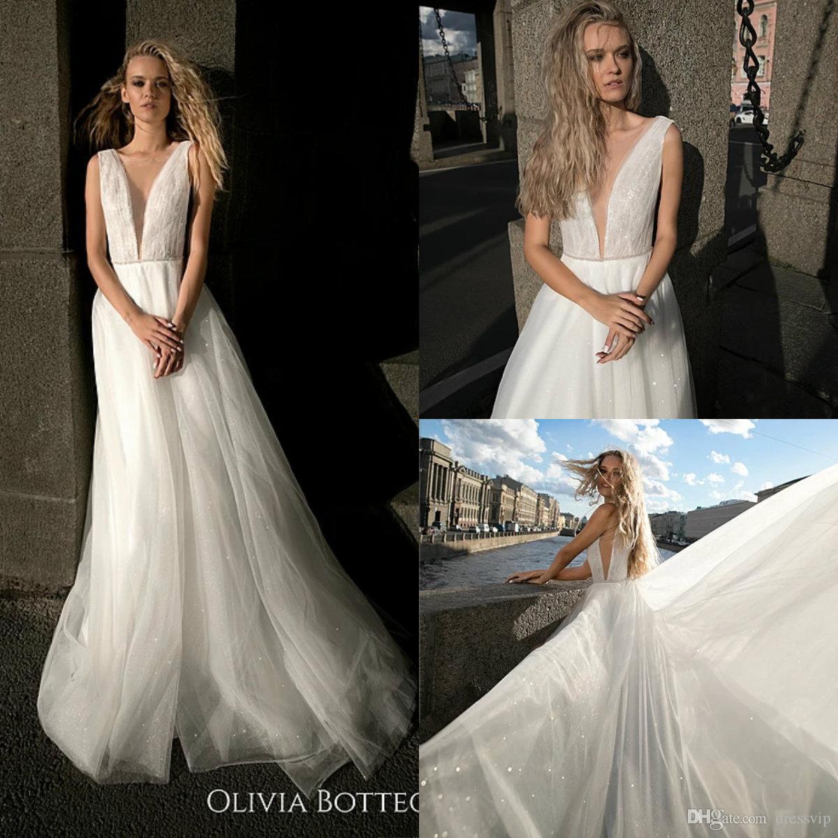 2829415f2f Discount 2019 A Line Beach Wedding Dresses Deep V Neck Sleeveless Glitter  Sequins Sweep Train Boho Wedding Dress Custom Made Bohemian Bridal Gowns  Second ...