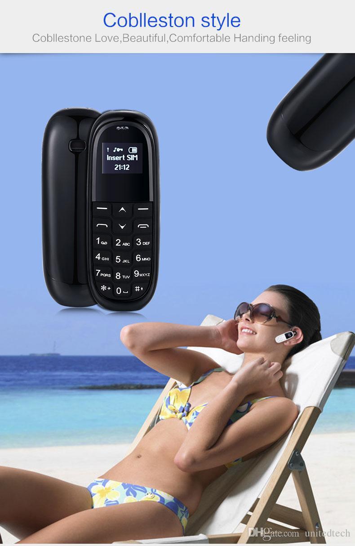 Mini téléphone portable de poche AEKU KK1 0.66 pouces Sans fil Bluetooth Casque Dialer Plus petit téléphone portable magique Voix Russe clavier téléphone portable