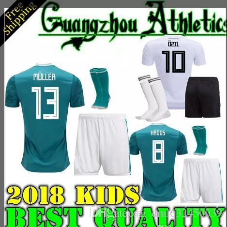 4daf75aec8a 2018 World Cup GERMANY Kids Soccer JerseyS OZIL KROOS DRAXLER HOME WHITE  Away Green HUMMELS SOCKS FOOTBALL JERSEY SHIRT Online with  20.72 Set on ...