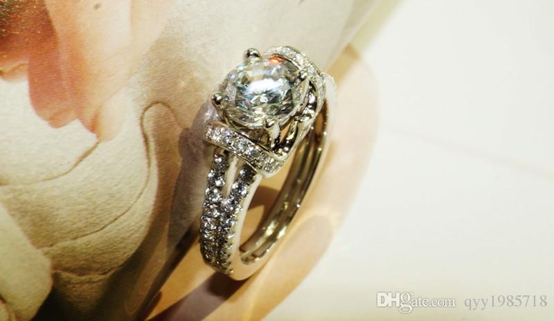 프로 모션 1CT 스타 여성을위한 유명한 브랜드 스털링 실버 결혼 반지 18K 화이트 골드 도금 합성 다이아몬드 반지 바그 Femme