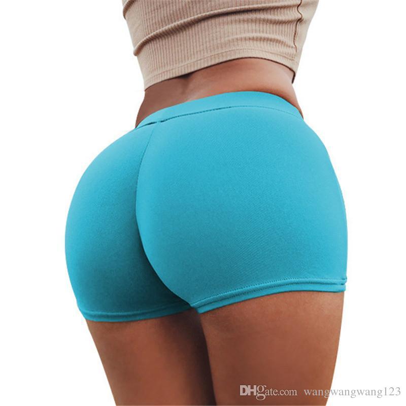 las mujeres manera de la señora elástico de la ropa interior de Europa Rusia Color Rojo Azul sólido lindo delgado apretado que resalta las caderas atractivas Gimnasio partido cortos bragas