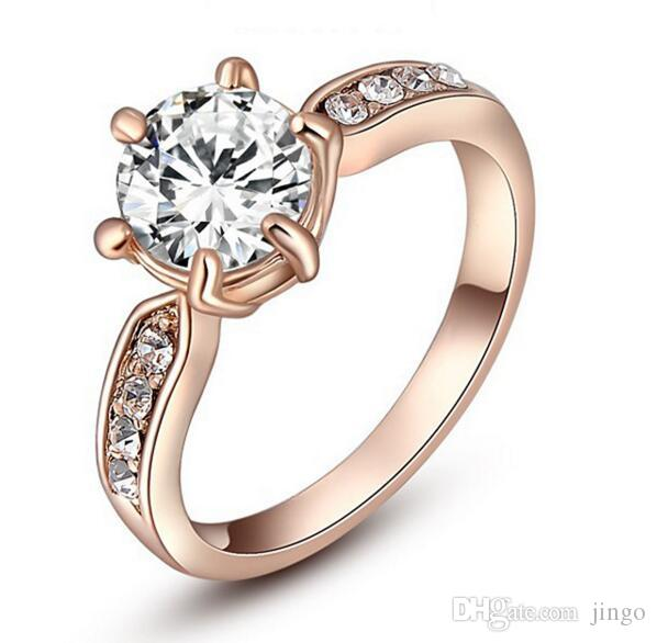 DHL 18 quilates de oro rosa chapado en oro Corazón y flechas Corte Cubic Zirconia Solitaire Anillos de compromiso de boda de cristal