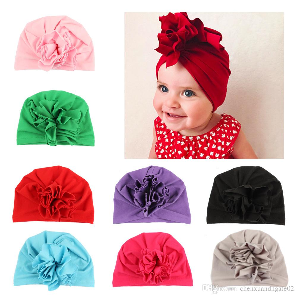0cb006c27c3 2019 New Flower Bowknot Baby Hats For Girls Autumn Winter Baby Girls Cap  Photography Props Elastic Infant Beanie Turban Hat Baby Hair Accessories  From ...