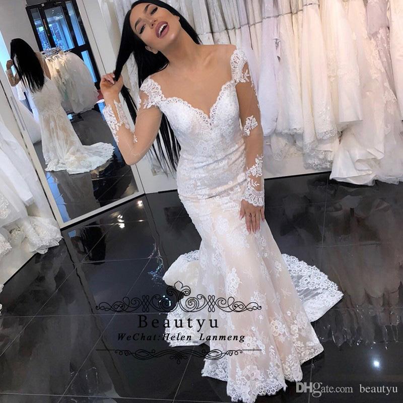 360eaaa5427 Sexy Lace Mermaid Wedding Illusion Long Sleeves Sheer Neck See Through Back  2019 New Arabic Bridal Gowns With Sweep Train Vestido De Novia Ivory Mermaid  ...