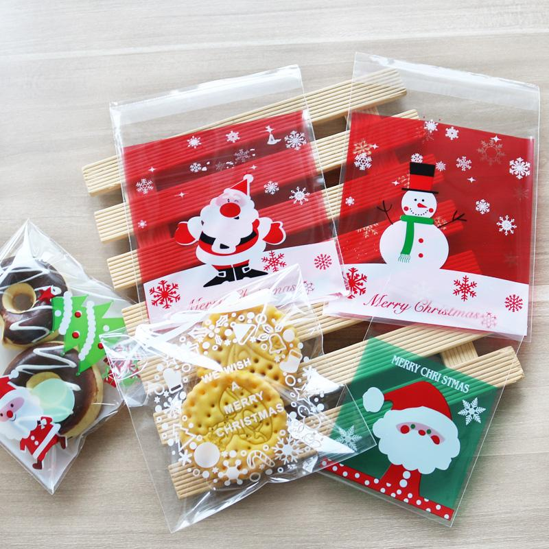 Merry Christmas Gift.50pcs Merry Christmas Plastic Bag 10x10cm Santa Claus Bags Snowflake Cookie Cellophane Candy Gifts Plastic Bags Party Decoration