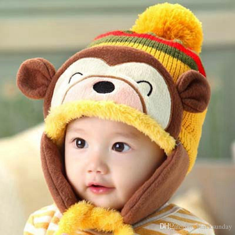 4cd7ed66ff0 Warm Kids Cartoon Hats Cute Monkey Beanies Kids Earmuffs Beanies Wool  Knitted Caps Winter Beanie For 4 Months 6 Years Children Knitted Hats Knit  Cap From ...