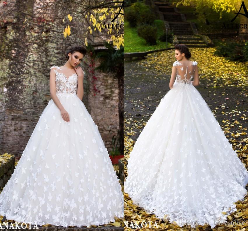 0e60df4bd689b Beautiful White Butterflies Hand Made Flowers Flare Fitted Bridal Wedding  Dresses New Sheer Neck Cap Sleeves Appliques Long Bridal Gowns