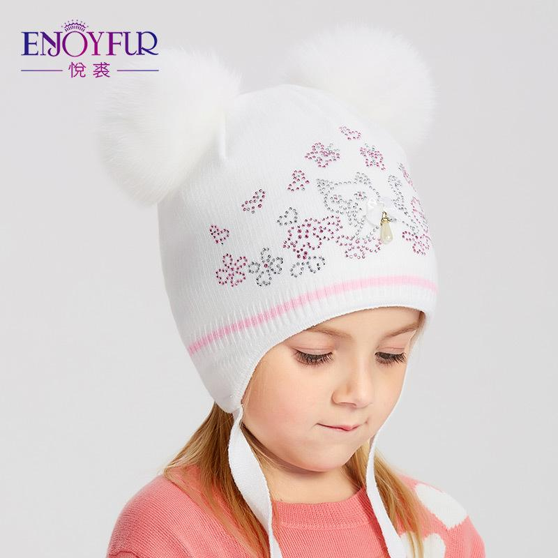 4a025280ad5 ENJOYFUR Girls Winter Hats Double Fox Fur Pompom Kids Hat Cute Cat Pattern  Rhinestone Beanies For Children Warm Knitted Caps D18110601 Beanie Hat Sun  Hats ...