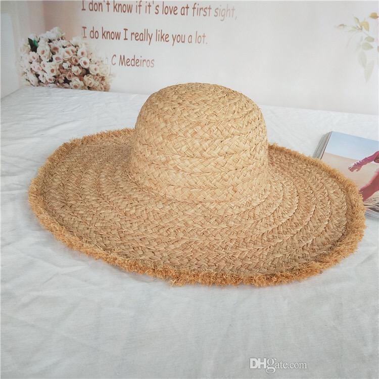 172a8350433 2018 Summer Woman And Girls Fashion Raffia Straw Beach Hat Wider Brim Hat  Raw Edge Hats Bucket Hats From Caphathouse