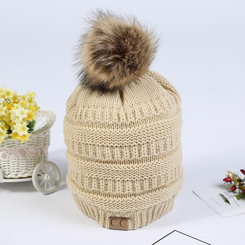 2018 CC Thick Warm Winter Hat For Women Soft Stretch Cable Knitted Pom Poms  Beanies Hats Women s Skullies Beanies Girl Ski Cap Mens Beanies Custom  Beanies ... 6aad184513f