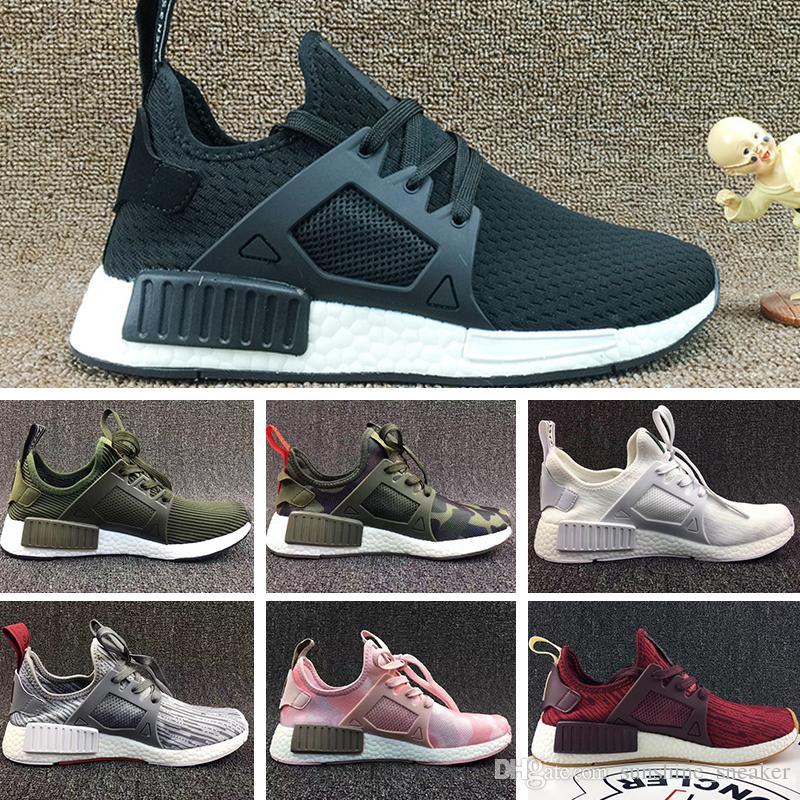 more photos 1fdd3 9b8af Acquista Adidas NMD HU Pharrell Basketball Shoes 2018 Sconto All ingrosso  Economici Rosa Rosso Grigio NMD Runner R1 Primeknit PK Bassa Scarpe Da  Donna Da ...