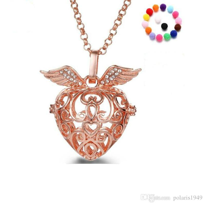 Wholesale heart shape wings aromatherapy pendant with 31 inch chain wholesale heart shape wings aromatherapy pendant with 31 inch chain essential oil diffuser necklace fashion jewelry 4 colours flower pendant necklace glass aloadofball Gallery