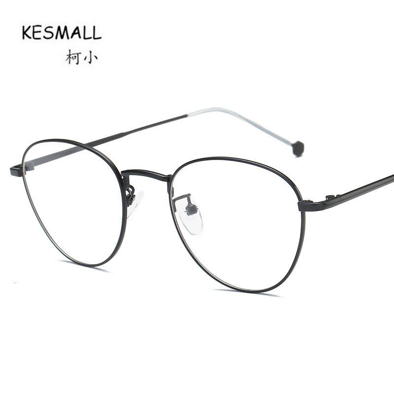Compre KESMALL 2018 La Más Nueva Moda Marcos De Gafas Ópticas Mujeres  Hombres Alta Calidad Miopía Gafas Marco Occhiali Donna Da Vista XN665 A   21.62 Del ... b1cc41f7d29d
