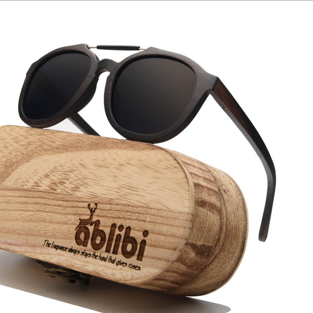 69bc82955e Compre Ablibi 2018 New Ebony Solid Wood Para Hombre Gafas De Sol Estilo  Callejero Lente Con Espejo Polarizado En Caja De Gafas De Sol De Madera  Oculos De ...