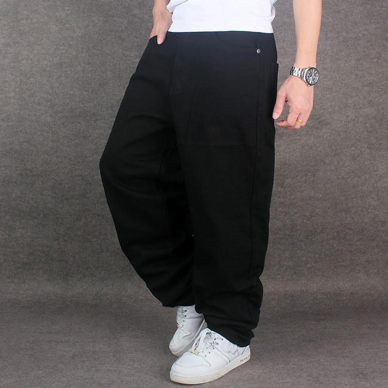 9e21f303e5cad Compre Hip Hop Baggy Jeans Negro Para Hombre Pantalones De Mezclilla De Hip  Hop Sueltos Rap Jeans Para Niño Rapero De Moda De Gran Tamaño 28 46 Famous  Brand ...