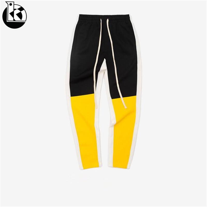 b5d86023078c8 Compre La Primavera Y El Otoño Nueva Tendencia Retro Hombres Pantalones De  Moda Contraste De Color A Rayas De Costura Modelos De Seis Colores Para  Hombre ...
