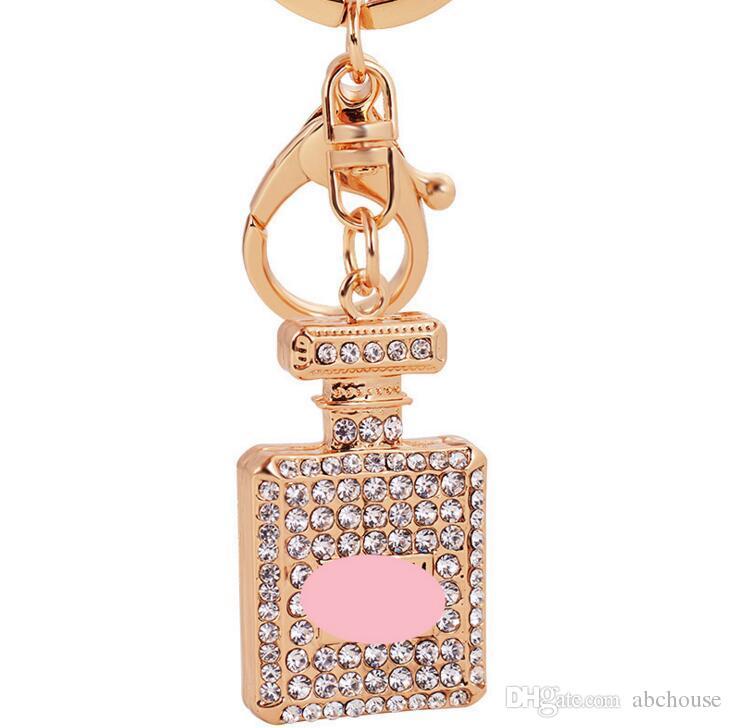 Diamante de cristal botella de perfume llavero mosquetón llavero anillos titulares bolso cuelga mujeres llaveros llavero de cristal es